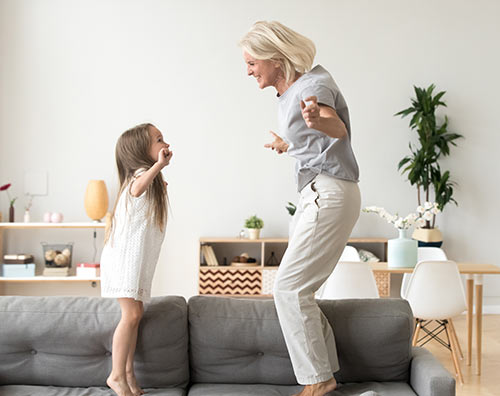 Woman Jumping on Couch